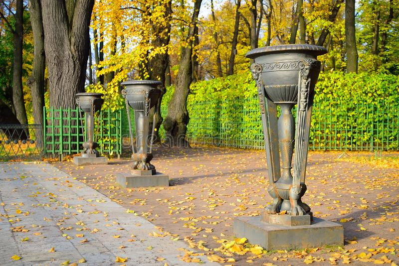 Iron vase in the Summer Garden in autumn on a Sunny day.  royalty free stock images