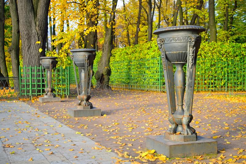 Iron vase in the Summer Garden in autumn on a Sunny day.  royalty free stock photo