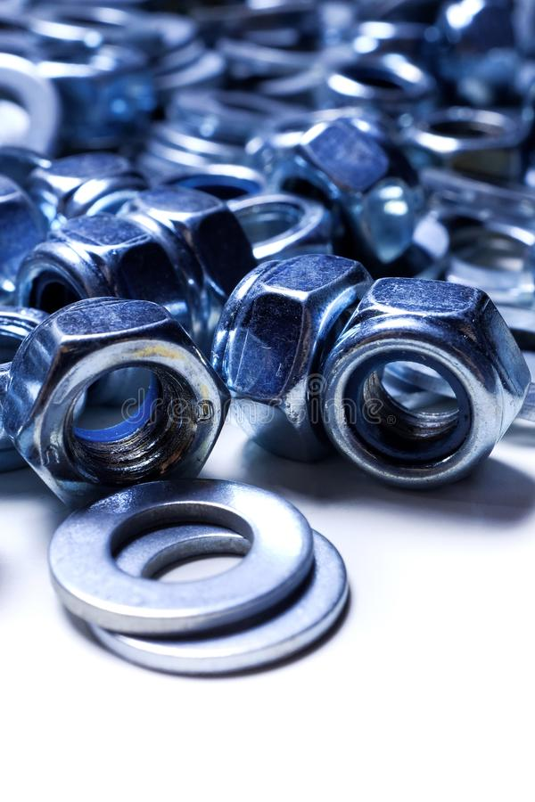 Iron washers and nuts mixed up close-up, texture, background royalty free stock photo