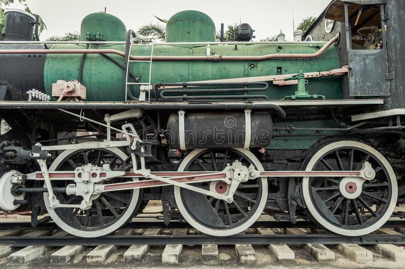 Iron wheels of steam engine locomotive train on railway track, old and classic period train. royalty free stock photos