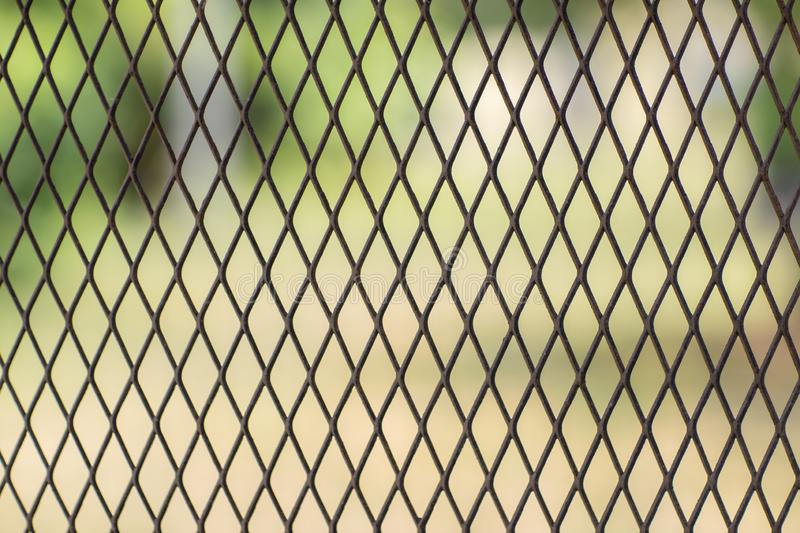 Iron wire fence. Fence grilles rust texture background. Fence Steel Background.  stock photos
