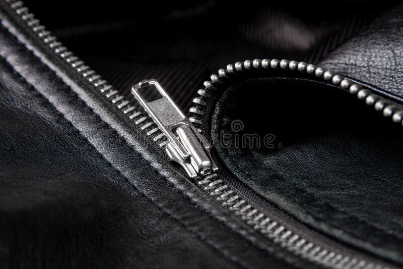 Iron zipper on a black leather jacket, needlework concept.  royalty free stock images