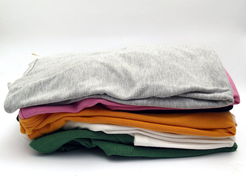 Ironed clothes. Clothes ironed and neatly stacked stock image