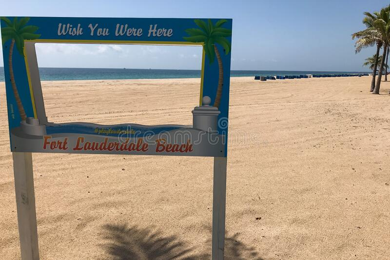 Ironic Sign Sits On Closed Florida Beach During Coronavirus Pandemic stock image