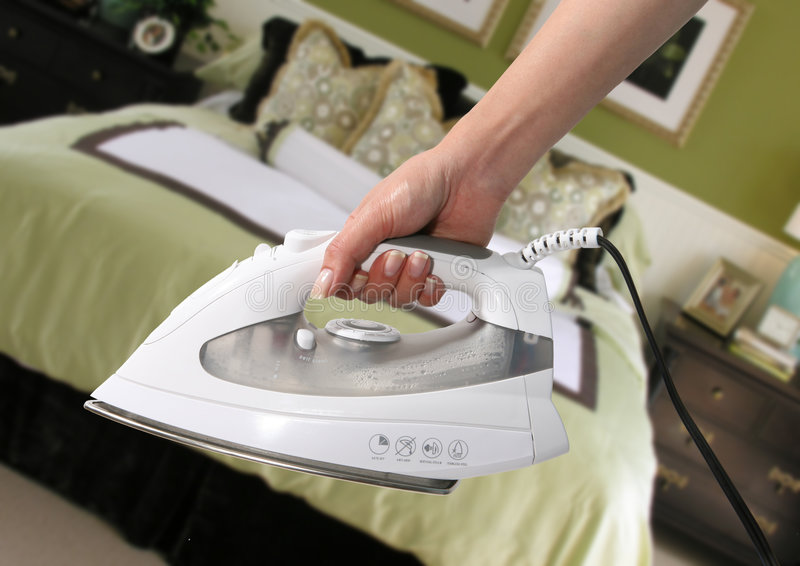 Ironing in the Bedroom royalty free stock photos