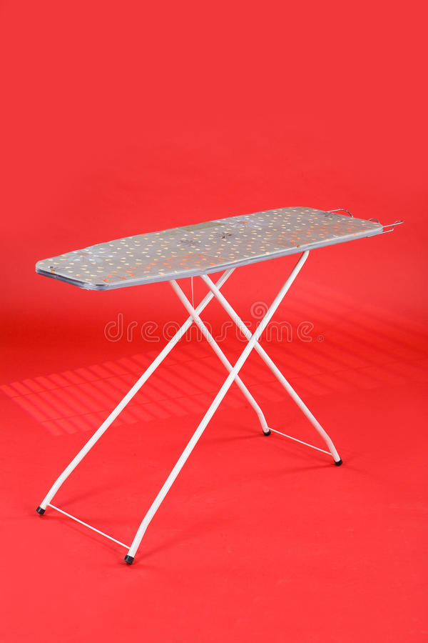 Ironing Board. On the red chromakey royalty free stock photography
