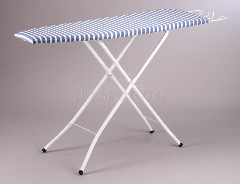Ironing board. An ironing board on the plain background royalty free stock photos