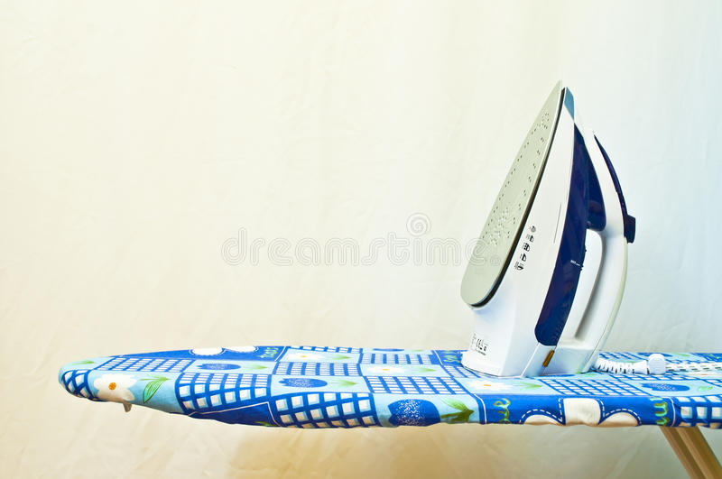 Ironing board. In blue color stock image