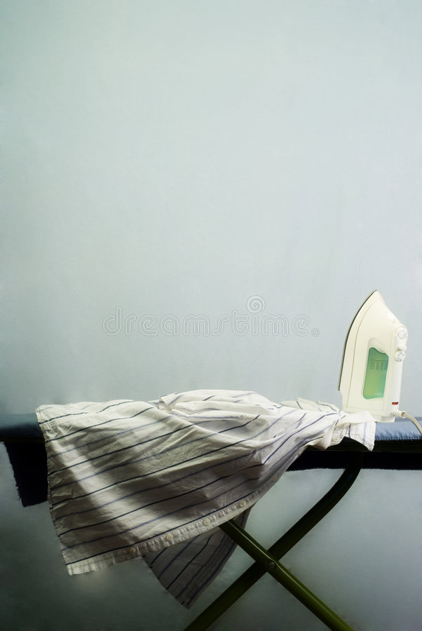 Ironing Board. An iron and ironing board with space for text above stock image