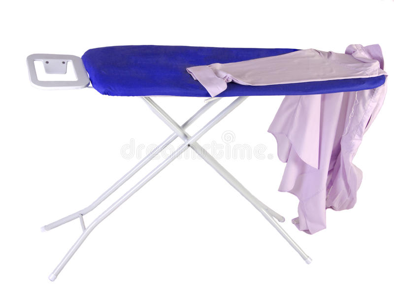 Ironing board with his work shirt. A work shirt on an ironing board on a white background stock photo