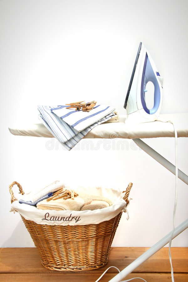 Ironing board with laundry stock photo