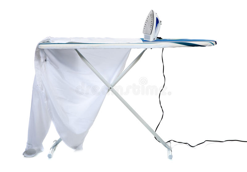 An ironing board with a shirt and an iron. A ironing board with a man's shirt and a household iron on a white background- household chores concept stock photos