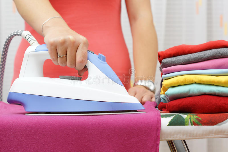 Ironing Clothes On Ironing Board.  royalty free stock photos