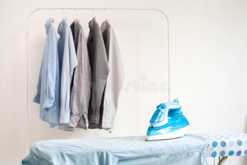 Ironing housework ironed folded shirts clean concept still life. Garment apparel cloth indoors royalty free stock image