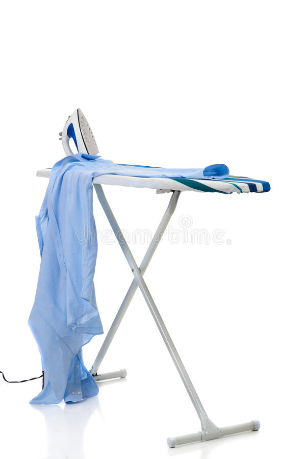 Ironing a shirt stock photography