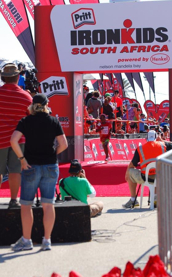 Ironkids athlete at finish line stock image