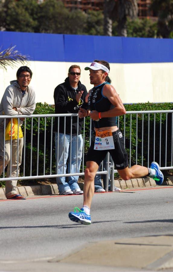 Ironman 2012 triathlete running stock photography