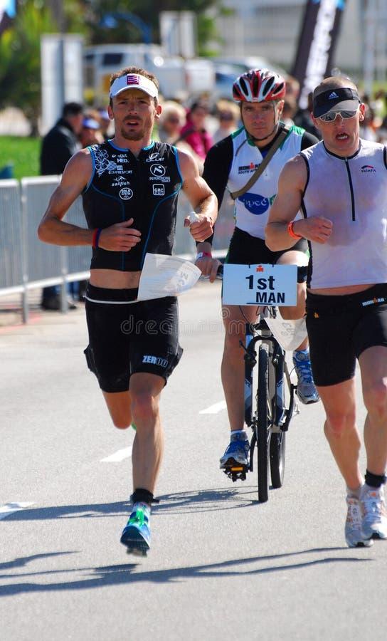 Ironman 2012 triathlete running royalty free stock photography