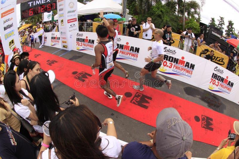 Ironman Philippines marathon run race finish. Participants of Cobra Energy Drink Ironman 70.3 Philippines running to the finish line in the marathon run race royalty free stock image