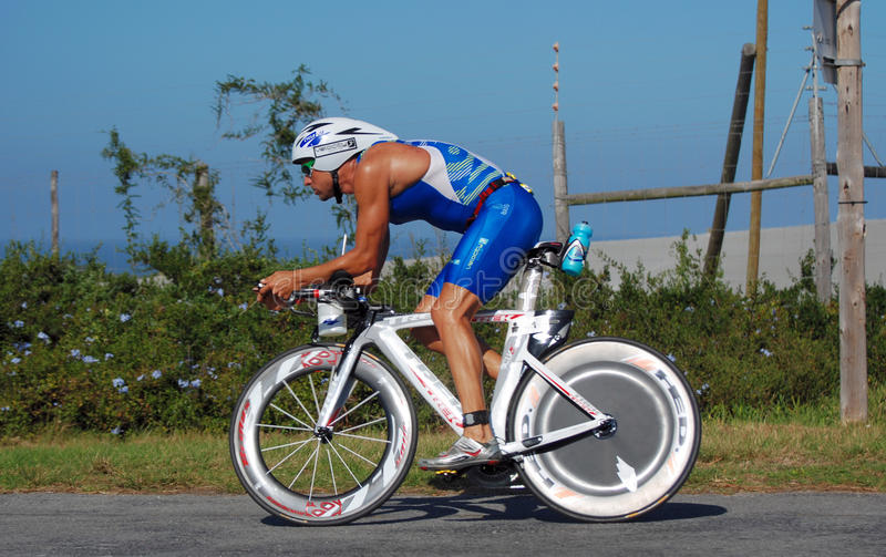 Ironman South Africa 2011. Professional triathlete, local hero and later winner of the race, Raynard Tissink, cycling on the road at the International sports royalty free stock photos
