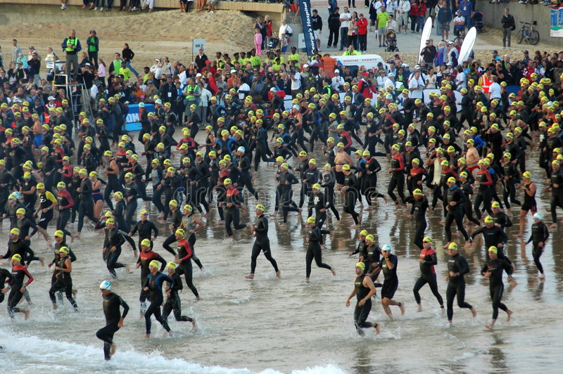 Ironman start. Group of triathletes running into the water at the start of the IRONMAN triathlon competition on the 18. March 2007 in Port Elizabeth, South stock images