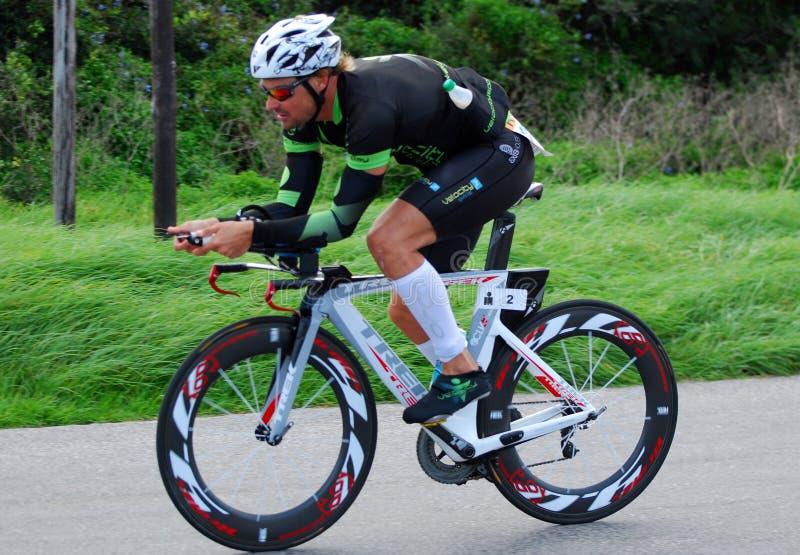 Ironman triathlete cyclist royalty free stock photo