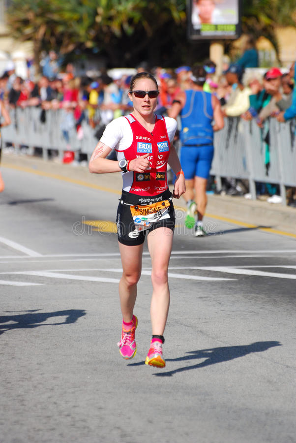 Ironman triathlete running stock photos