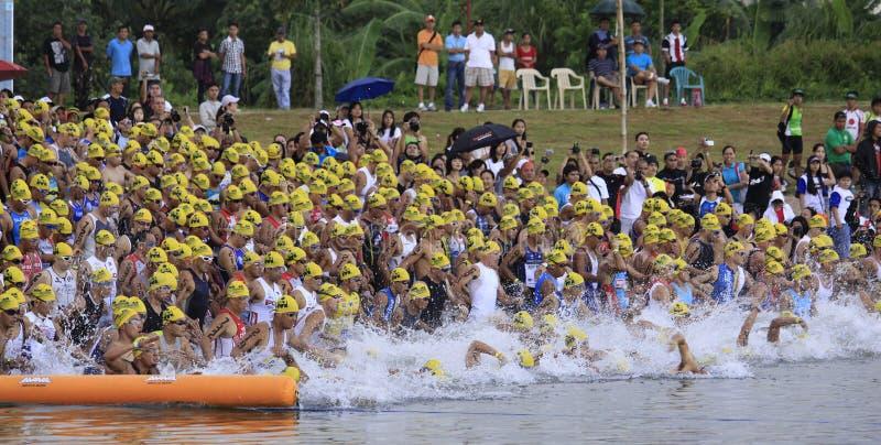 Ironman triathllon swimming race start. Participants of Cobra Energy Drink Ironman 70.3 Philippines at the starting line in the swimming race event in Camarines stock image