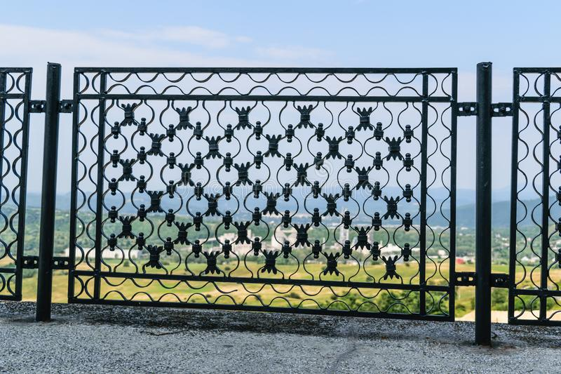 Ironwork metal fence - detail of beautiful decorative manual forged metal fence stock images