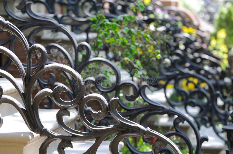 Ironwork Victorian Style. Detail of railing on steps of classic Boston South End house entrance stock photo