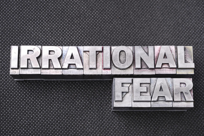 Irrational fear bm. Irrational fear phrase made from metallic letterpress blocks on black perforated surface royalty free stock photo