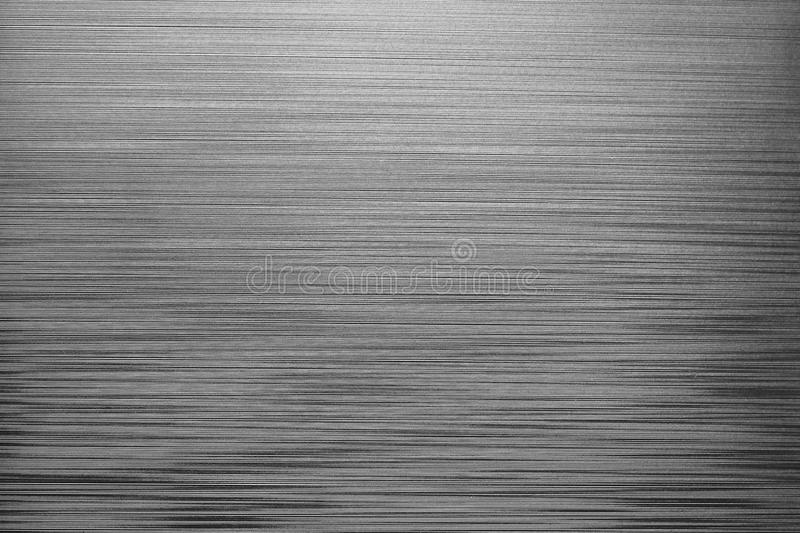 Irregular horizontal lines background. Grey plastic texture stock photography