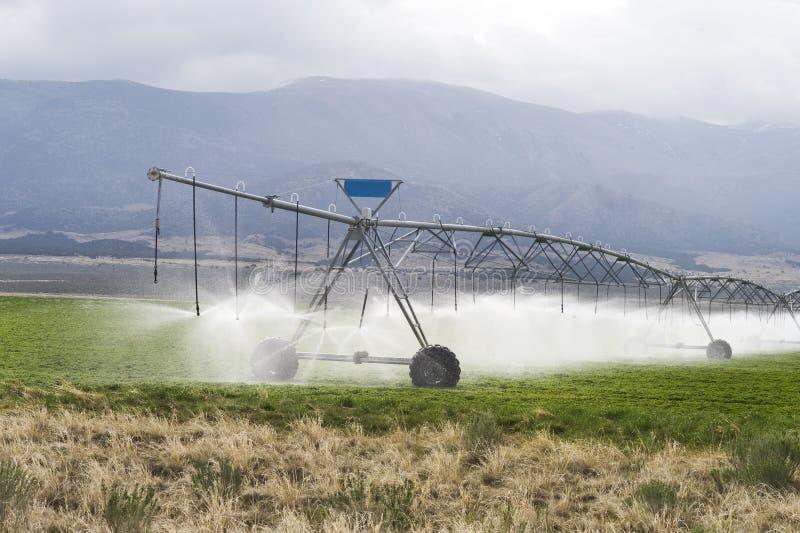 Irrigating Farmland. Irrigating farmland outside of Salt lake City,UT stock photo