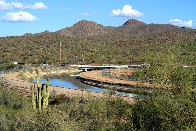 USA, Arizona: Road Crossing Irrigation Canal royalty free stock image