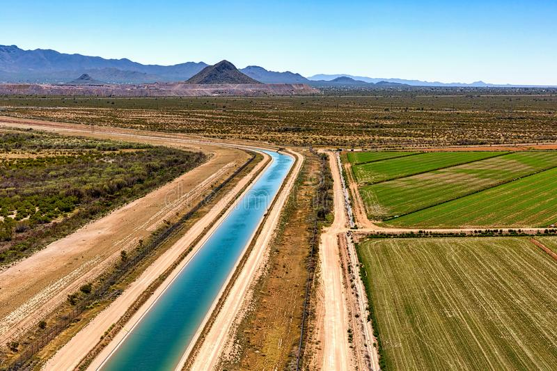 Irrigation canal and agriculture in Avra Valley stock photos
