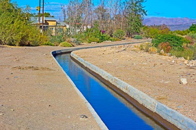 Irrigation canal in arid region. Irrigation canal near Orange River in arid region of Northern Cape, South Africa royalty free stock images