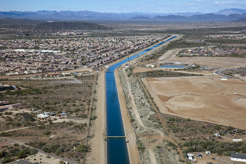Download Irrigation Canal Through Suburbia Stock Photo - Image: 26145160