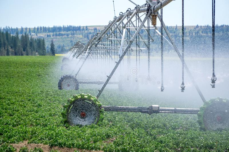 Irrigation equipment on farm field on sunny day royalty free stock photography