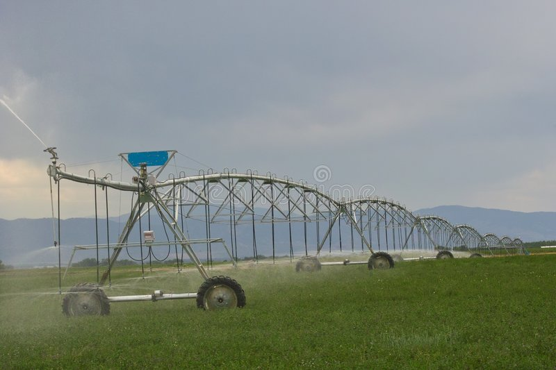 Irrigation pumps in fields royalty free stock photography