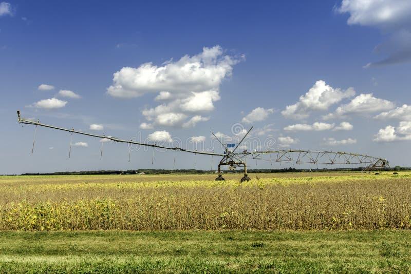 Irrigation system against blue sky stock photos