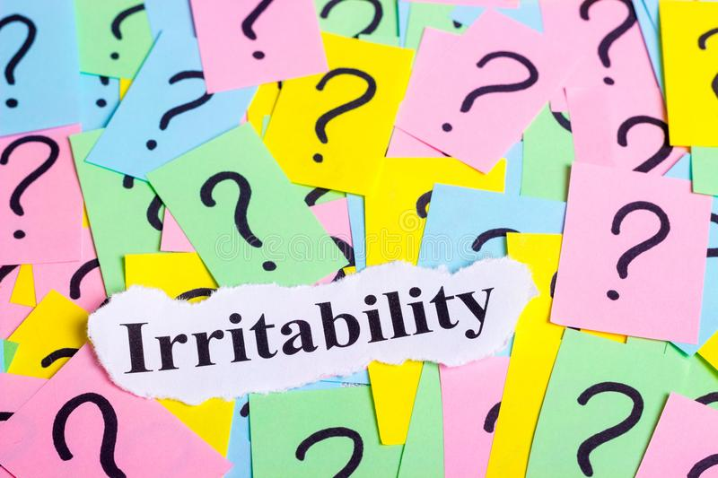 Irritable Syndrome text on colorful sticky notes Against the background of question marks.  royalty free stock photo