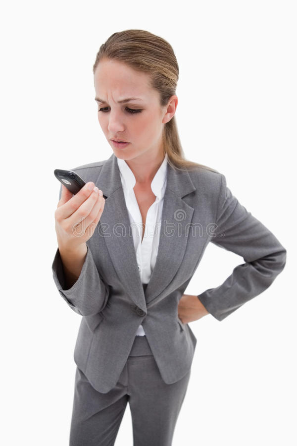 Irritated bank employee reading text message. Against a white background royalty free stock photo