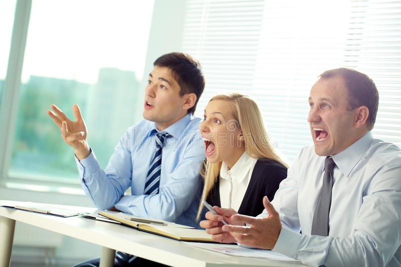 Irritated committee. Committee of three people shouting at a speaker stock photos