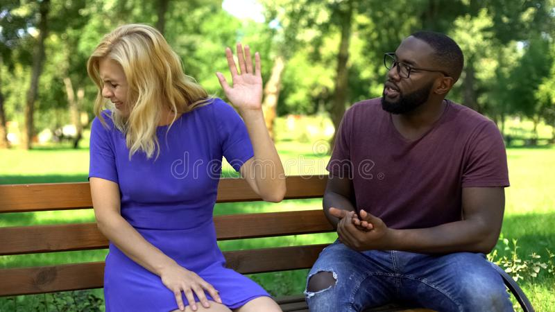 Irritated couple quarreling and breaking up in park, different expectations. Stock photo stock photo