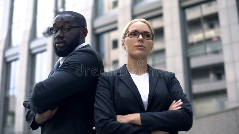 Irritated coworkers have disagreement in business, confrontation of ideas stock image