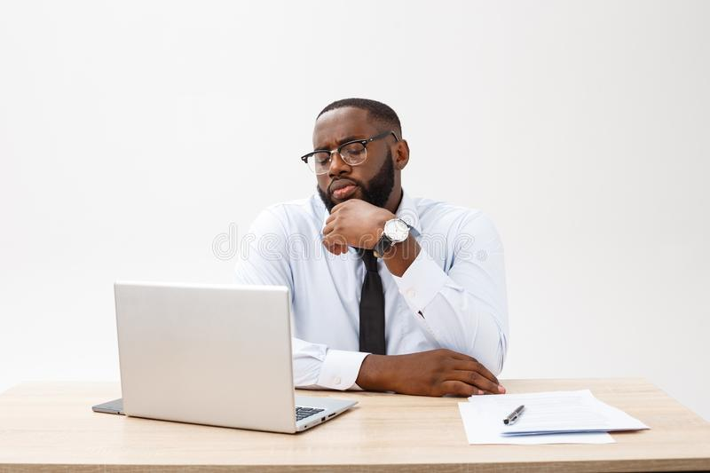 Irritated dark skinned young male enterpreneur being on working place feels very stressed and angry as cannot manage to royalty free stock photo
