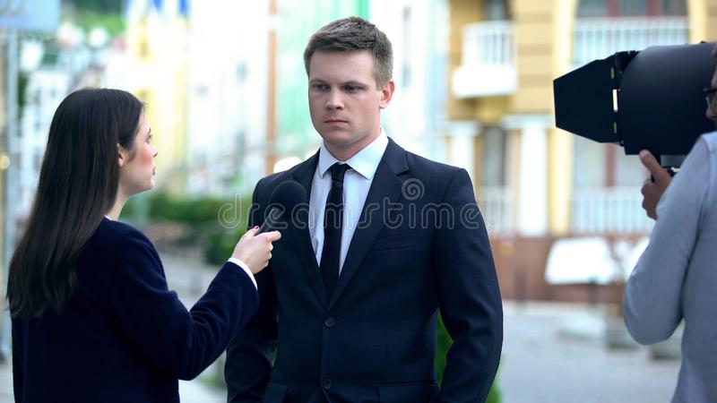 Irritated dissatisfied politician giving interview in provocative TV program. Stock photo stock image