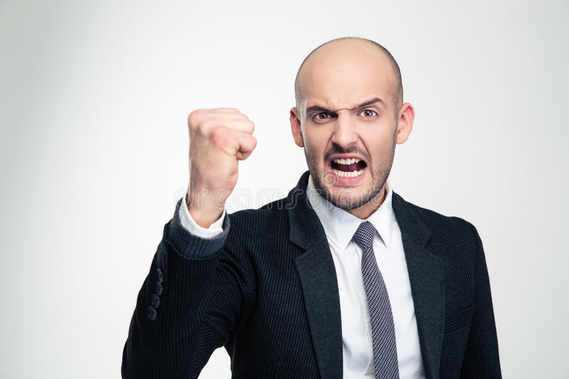 Irritated furious young business man shouting and showing fist stock photo