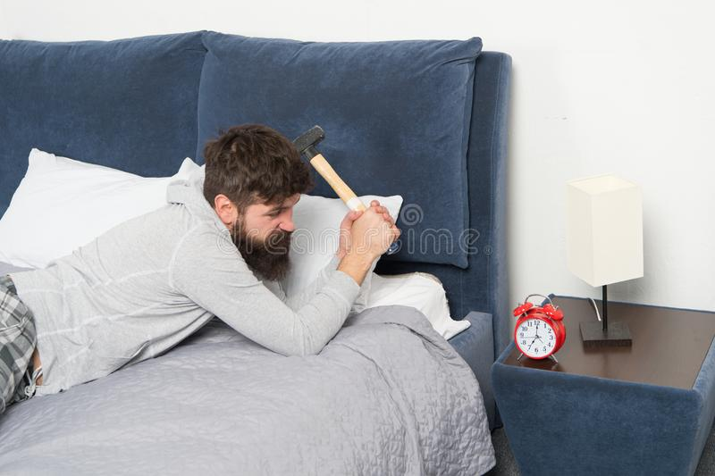 Irritated guy destroy annoying clock. Sleep longer. Health care concept. Although you sleep you may wake up feeling like. Did not sleep at all. Stages of sleep royalty free stock photo
