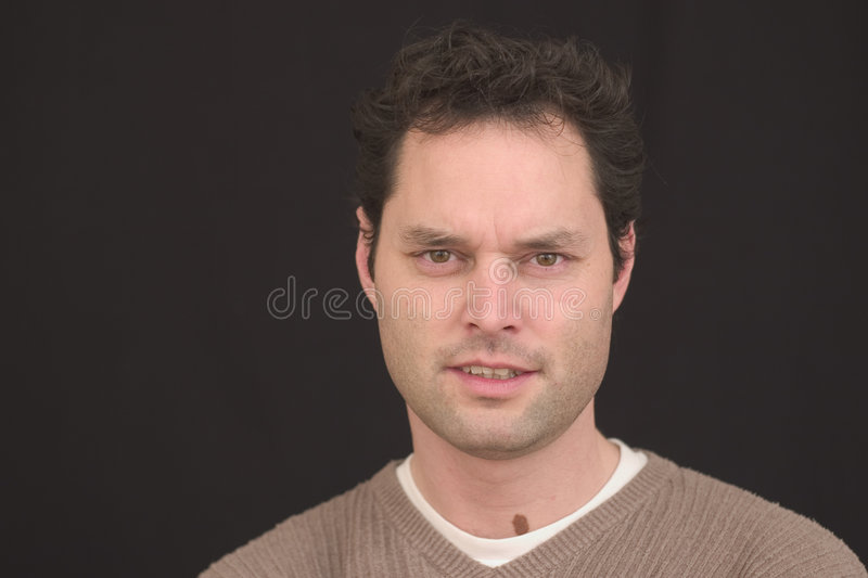 Irritated Man. Man looking somewhat irritated because the photographer was taking her time stock photos